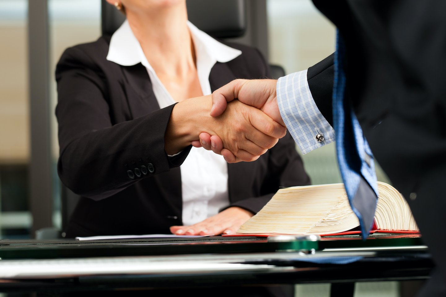 Female Lawyer Shaking Hands