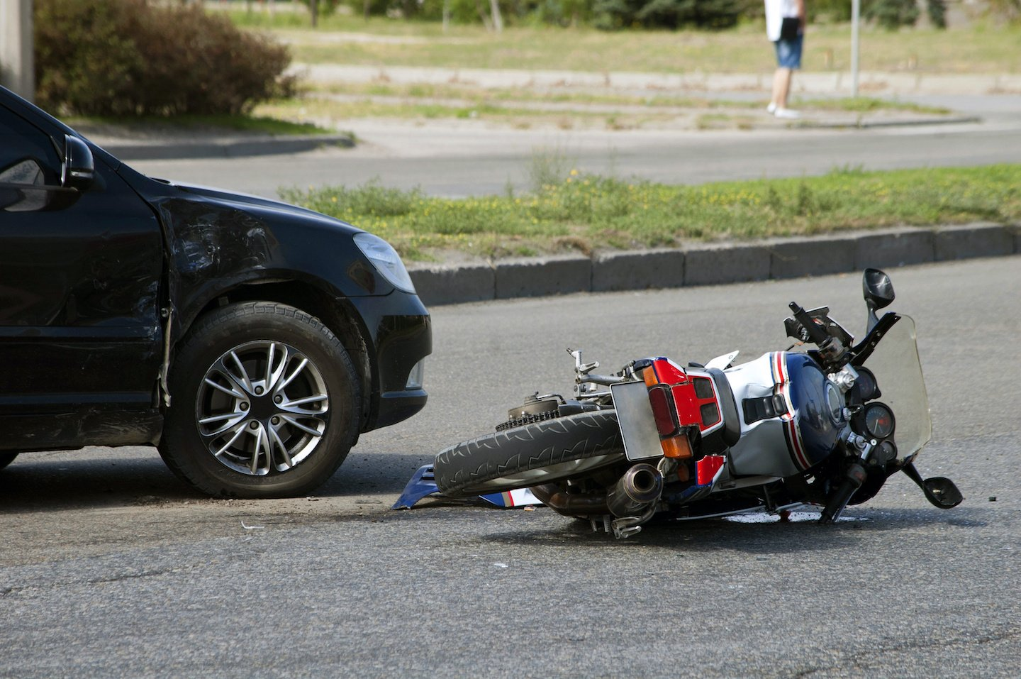 Motorcycle and Car Accident on Street